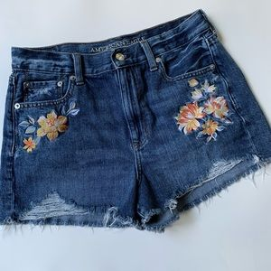 American Eagle distressed embroidered jean shorts.